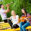 Stock Photo: Young friends play the guitar and trumpet