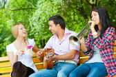 Young friends play the guitar and trumpet — Stock Photo