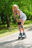 Girl roller-skating in the park — Stock Photo