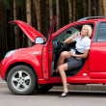 Blonde and broken car — Stock Photo #6682011