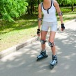 Girl roller-skating in the park — Stock Photo #6682111