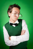 Nerd is standing with crossed arms — Stock Photo