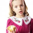 Girl with an apple — Stock Photo