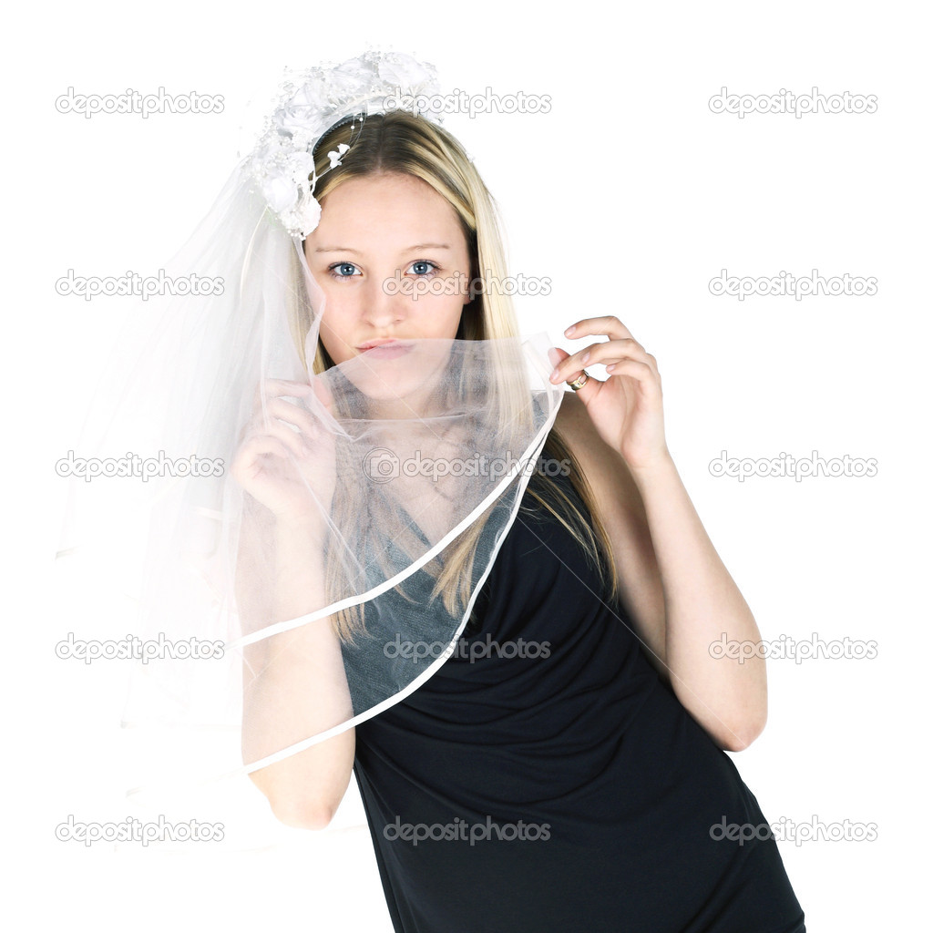 Young girl trying on the wedding veil — Stock Photo #5632641