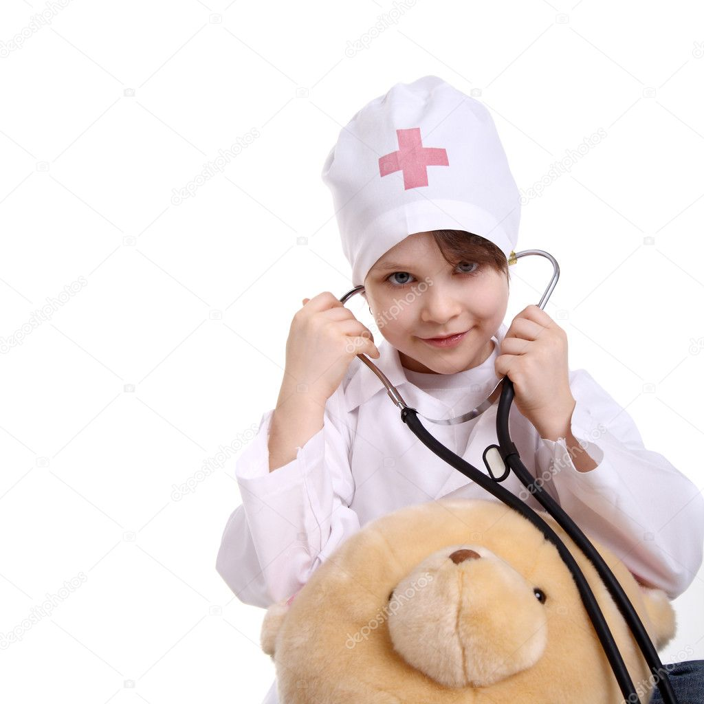 Girl at the doctor for a checkup pediatric doctor examining little