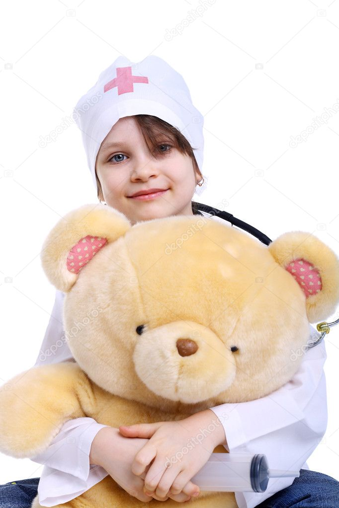 Smiling little girl playing a doctor with her toy bear — Stock Photo #5675565
