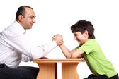 Family arm wrestling — Stock Photo