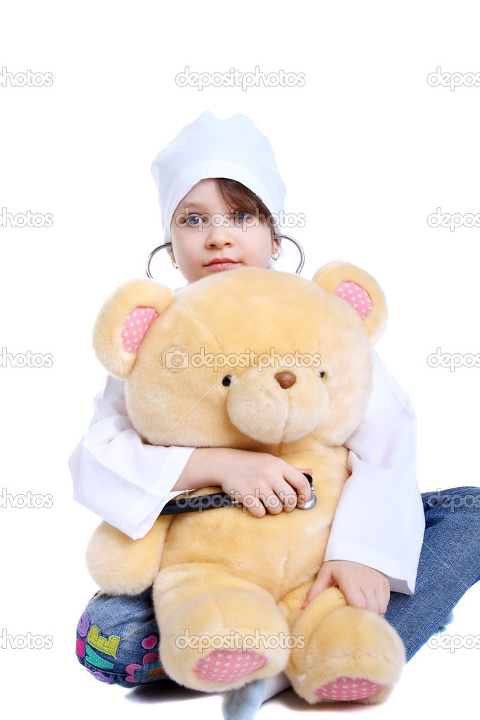 Smiling little girl playing doctor with her toy bear — Stock Photo #5726874