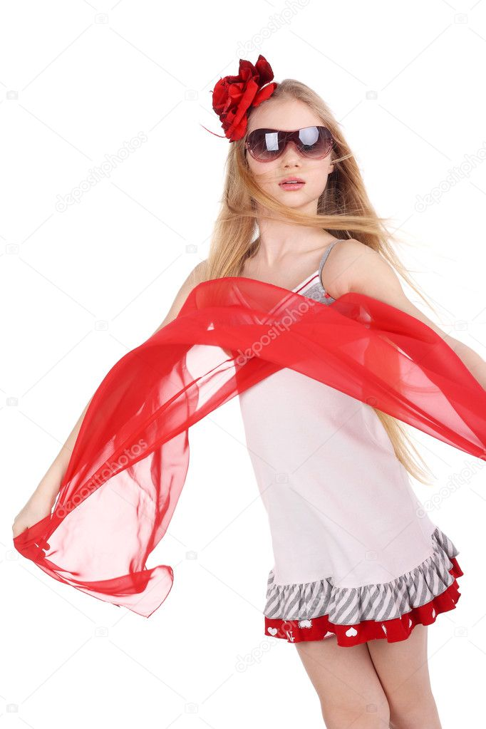 Beautiful teenage girl dancing in red in studio — Stock Photo #5839254