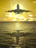 Sunset and airplane — Stock Photo