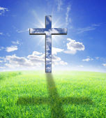 Cross and sunlight — Stock Photo