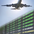 Airplane fliying over flight schedule — Stock Photo
