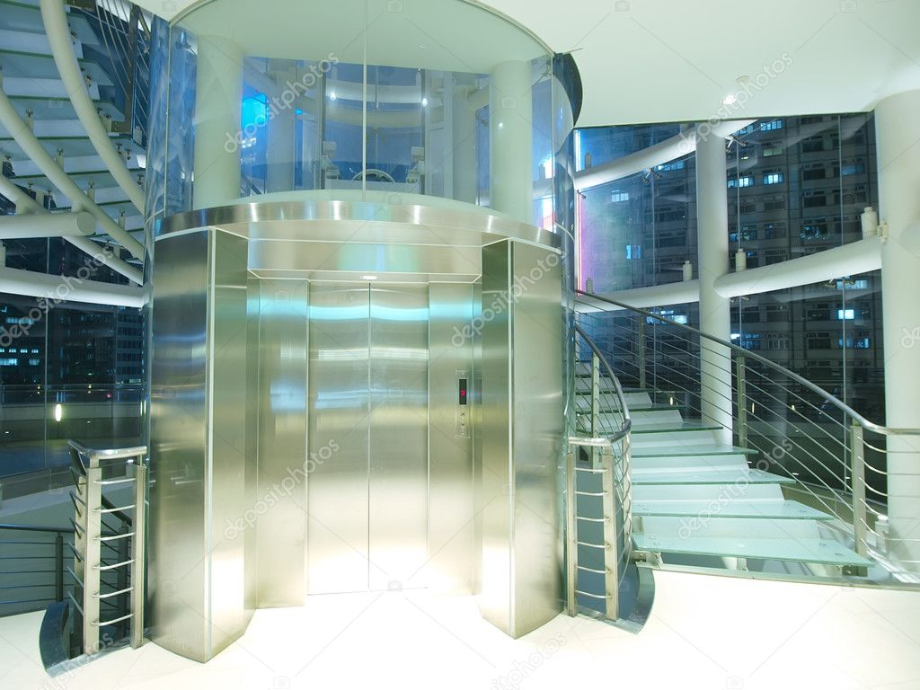 Transparent elevator and staircase  Stock Photo #5892327