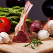 Raw lamb meat and assorted vegetables — Stock Photo