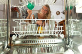 Young woman seen from inside of a dish washer — Stock Photo