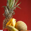 Royalty-Free Stock Photo: Pineapple and other fruits on a table