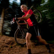 Handsome mcarrying mountain bike — Stock Photo #5889712