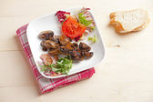 Marinated champignons and some salad in a bowl — Stock Photo