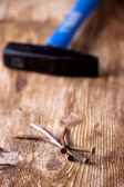 Closeup of rusty nails on a wooden plank — Stock Photo