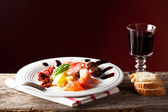 Mixed italian antipasti on a plate with wine — Stock Photo