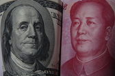 Chinese and American currency — Stock Photo