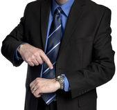 Hombre de negocios está señalando su reloj — Foto de Stock