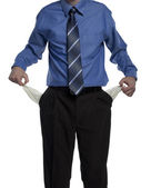 Business man with empty pockets — Stock Photo