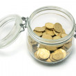 Coins in Glass Jar — Stock Photo
