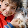 Royalty-Free Stock Photo: Teenage boy with goatling