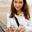 Teenage girl with shells — Stock Photo