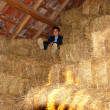 Boy on straw bales — Stock Photo #5715466