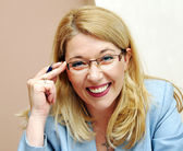 Businesswoman in glasses smiling — Stock Photo