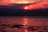Sunrise on riverbank — Stock Photo