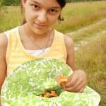 Teenage girl with mushrooms — Stock Photo #6431653