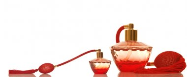 Perfume in a red glass bottles
