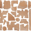 Pieces of torn brown corrugated cardboard — Stockfoto