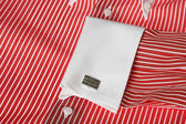 Cuff link on men's red shirt — Stock Photo