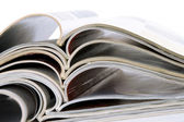 Pile of magazines with bending pages — Stock Photo