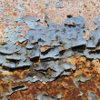 Peeling paint on a rusty metal plate — Stock Photo