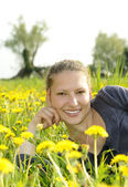 Woman on a flower meadow — Stock Photo