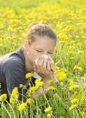 Woman with handkerchief on a meadow — Stock Photo