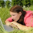 Royalty-Free Stock Photo: Woman with laptop on a meadow