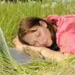 Stock Photo: Woman sleeping on laptop