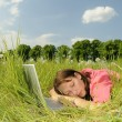 Woman sleeping on laptop — Stock Photo