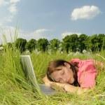 Woman sleeping on laptop — Stock Photo #5630789