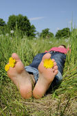 Woman is barefoot on a meadow — Stock Photo