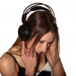 Pretty young woman listening to music — Stock Photo