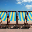 Row of colourful deckchairs on Weymouth beach - Stock Photo