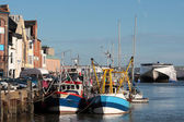 Boats and trawers in Weymouth harbour — Stock Photo