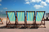 Row of colourful deckchairs on Weymouth beach — Stock Photo